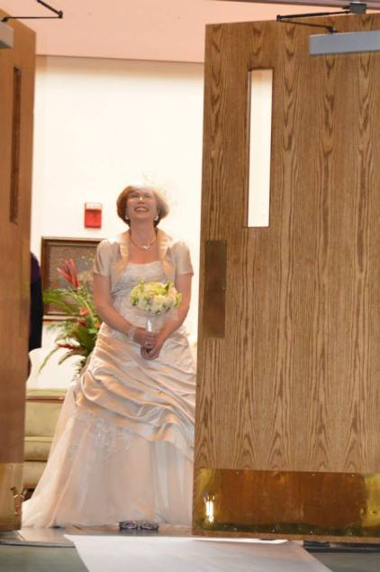 70 year old bride, blushing bride, bridal gown